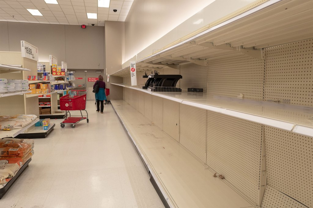 Empty shelves are visible at a Target retail store in California.