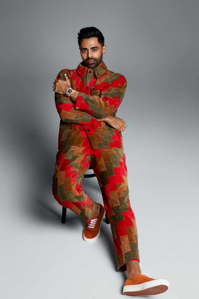 Hasan Minhaj posing in a jacket and trousers from Bode.