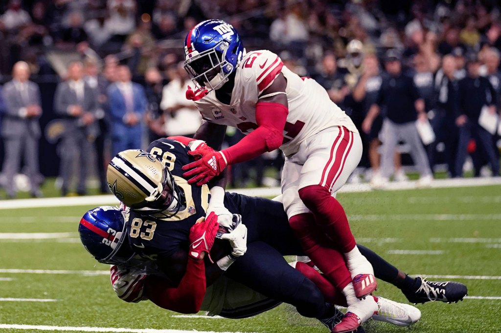 New Orleans Saints tight end Juwan Johnson (83) pulls in a touchdown reception against New York Giants cornerback Logan Ryan and New York Giants free safety Jabrill Peppers (21) in the first half of an NFL football game in New Orleans, Sunday, Oct. 3, 2021. (AP Photo/Brett Duke)
