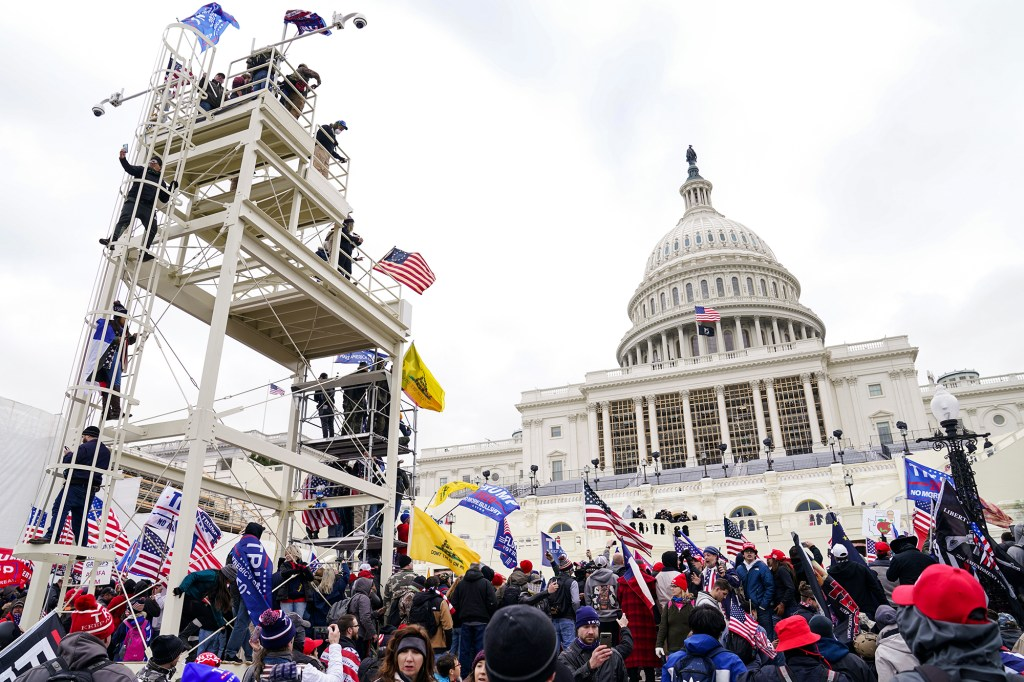 Rioters clash with authorities before successfully breaching the Capitol building.