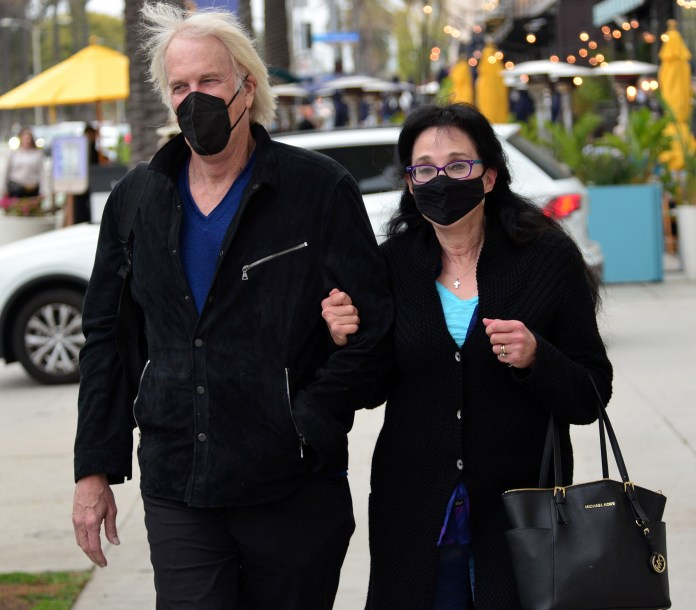 John Tesh with wife Connie Sellecca who played a major role in helping him to overcome cancer.