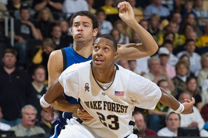 James Johnson (23) of the Wake Forest Demon Deacons boxes out David McClure (14) of the Duke Blue Devils at the LJVM Coliseum on February 17, 2008 in Winston-Salem, North Carolina.