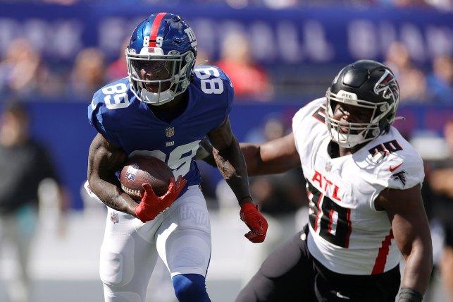 New York Giants' Kadarius Tony runs the ball.