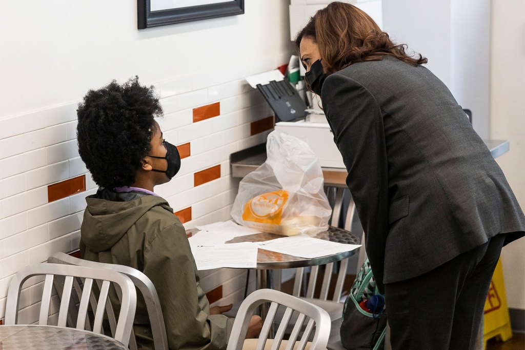 Vice President Harris speaks with a student during her pit stop following a tour at a COVID-19 vaccination site in New Jersey.