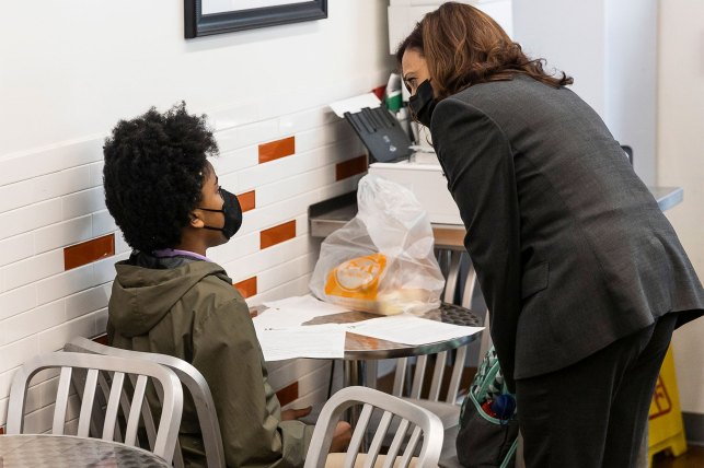 Vice President Harris talks to a student during his pit stop after visiting a COVID-19 vaccination site in New Jersey.