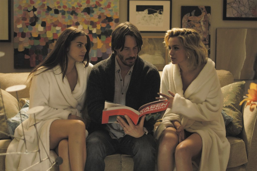 """A still from the film """"Knock Knock,"""" starring Keanu Reeves"""