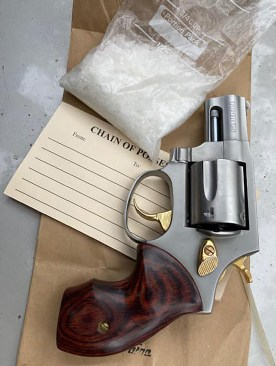 James Kertz's bag of meth and drug paraphernalia were clearly visible on the coffee table behind the exhaust emission device he was trying to get rid of.