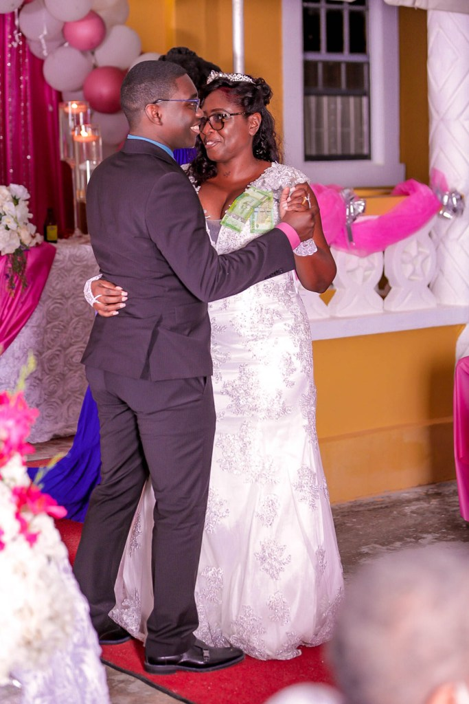 Holder dances with his mom on her big day.