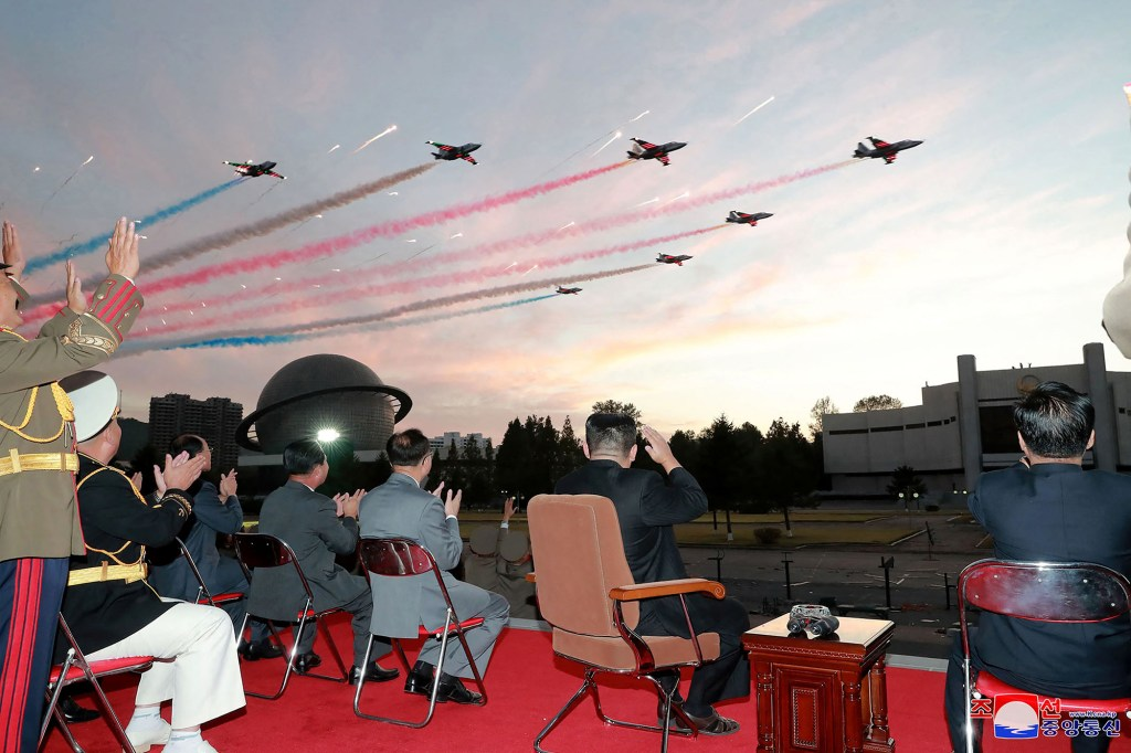Kim Jong Un watching planes.