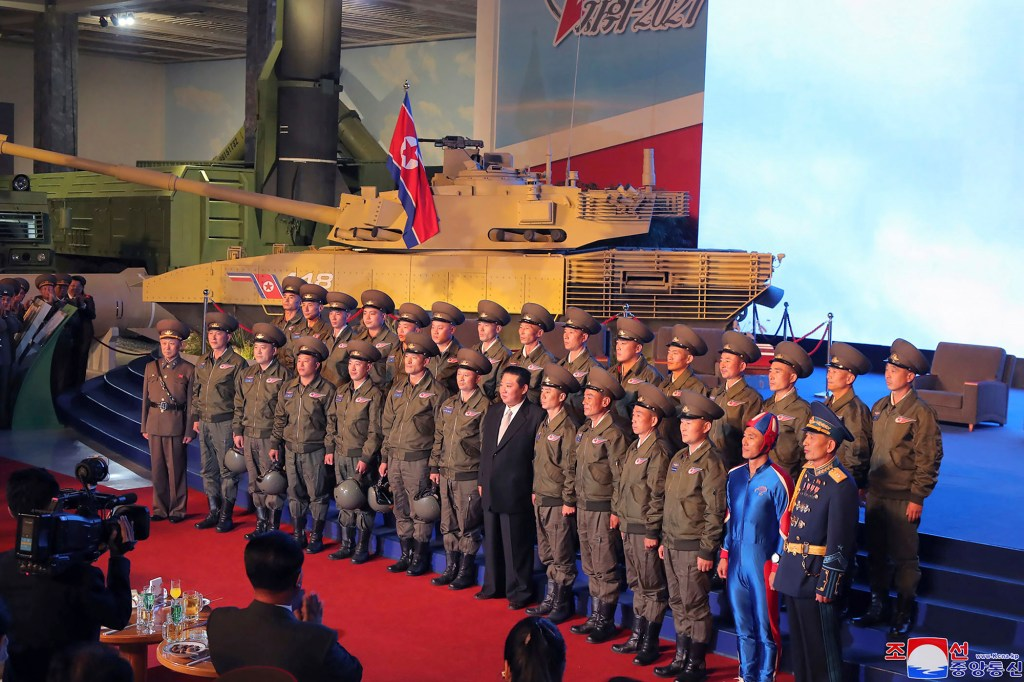 North Korean leader Kim Jong Un poses for a group photo with fighter pilots.