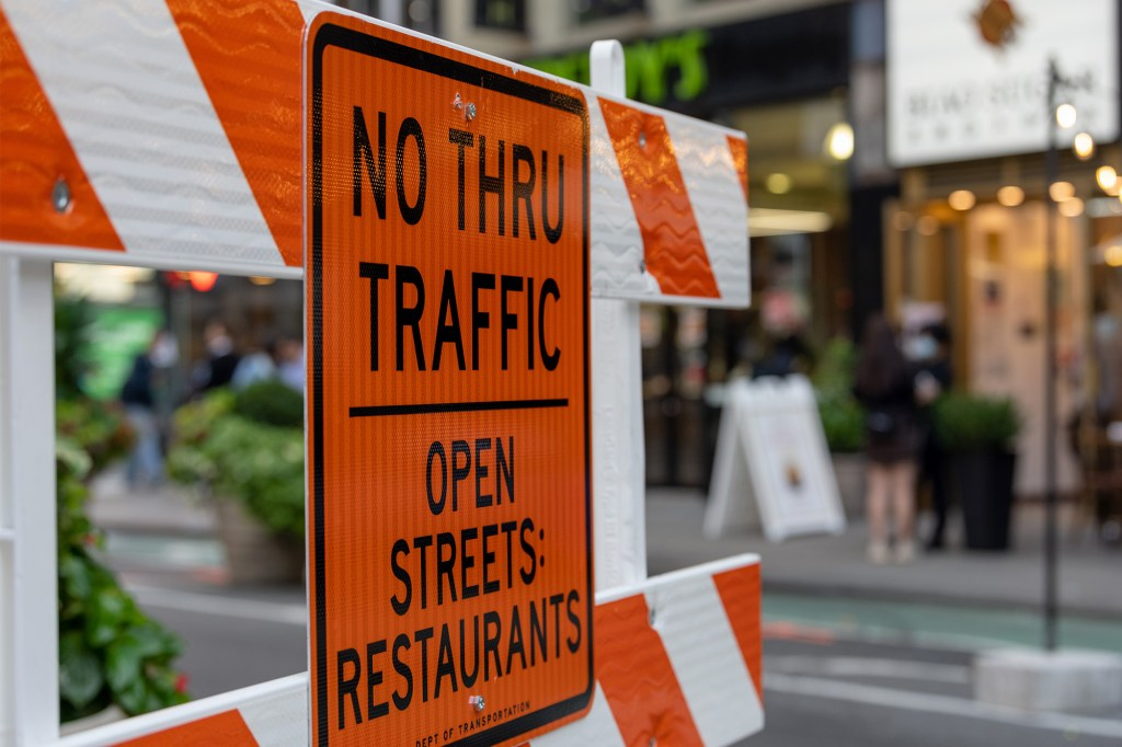 """A sign for an """"open street"""" near Herald Square. The city first started closing certain streets to vehicle traffic at the beginning of the COVID-19 pandemic."""