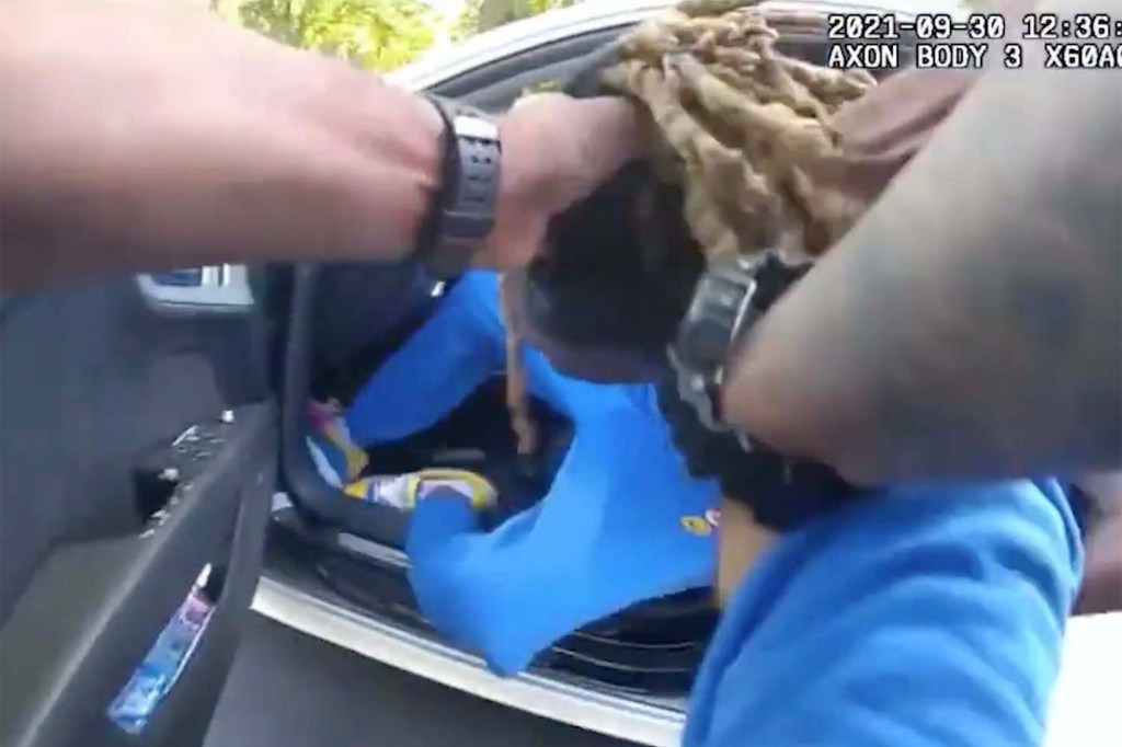 Police officers appeared to grab Owensby by his hair to remove him from the vehicle.