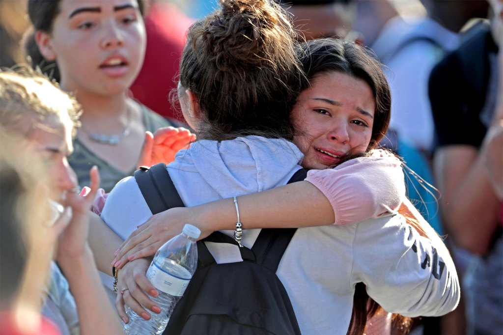 Students are released from a lockdown outside of Stoneman Douglas High School in Parkland, Fla., after a shooting on Wednesday, Feb. 14, 2018.
