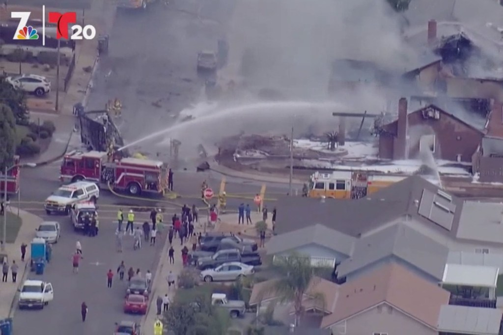 The scene of where a plane crashed into a neighborhood in Santee, California.