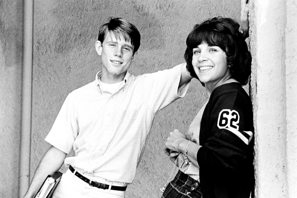 """Photo showing Ron Howard and Cindy Willliams posing on the set of """"American Graffiti."""""""