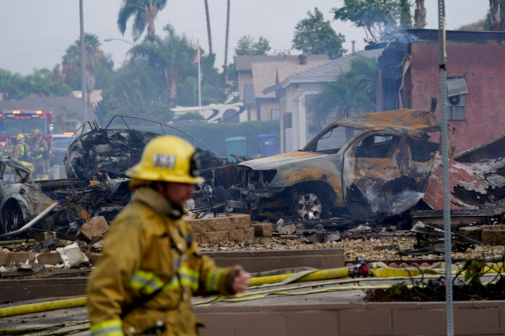 Fire crews work the scene of a small plane crash.