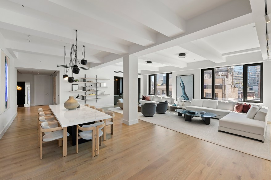 The living room and dining room are joined in an open floor plan.