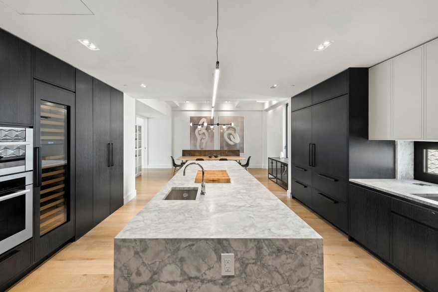 The eat-in kitchen has an island breakfast bar, dual refrigerators, oversized wine storage, dual ovens, built-in burners, oversized dishwashers, according to the listing.