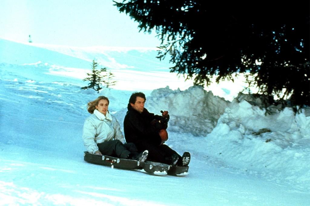 """Timothy Dalton turns a cello case into a sled in """"The Living Daylights."""""""