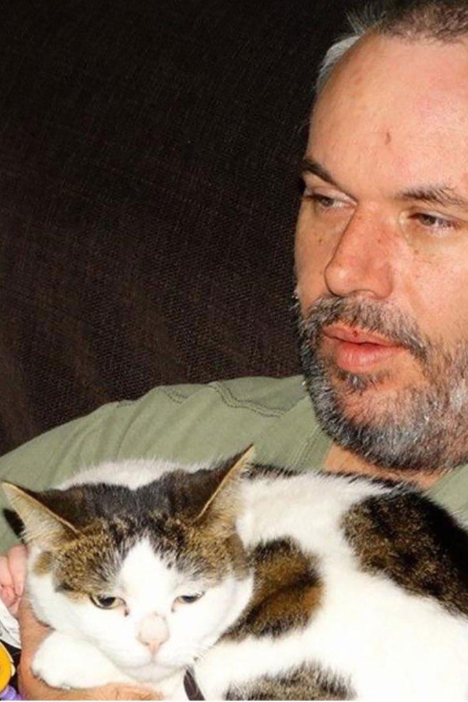 Tony Wittman with his cat.