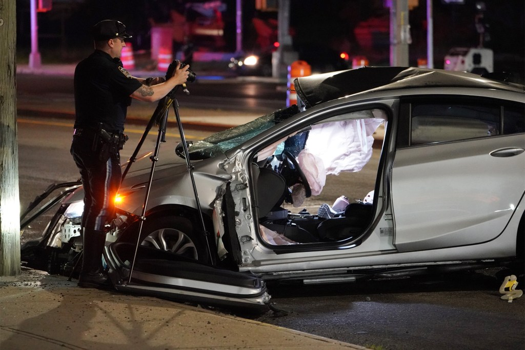 Police at the scene where two people were killed in a two car crash on Guy R. Brewer Boulevard and Rockaway Boulevard in Queens, NY around 9:15 p.m. on July 24, 2021.