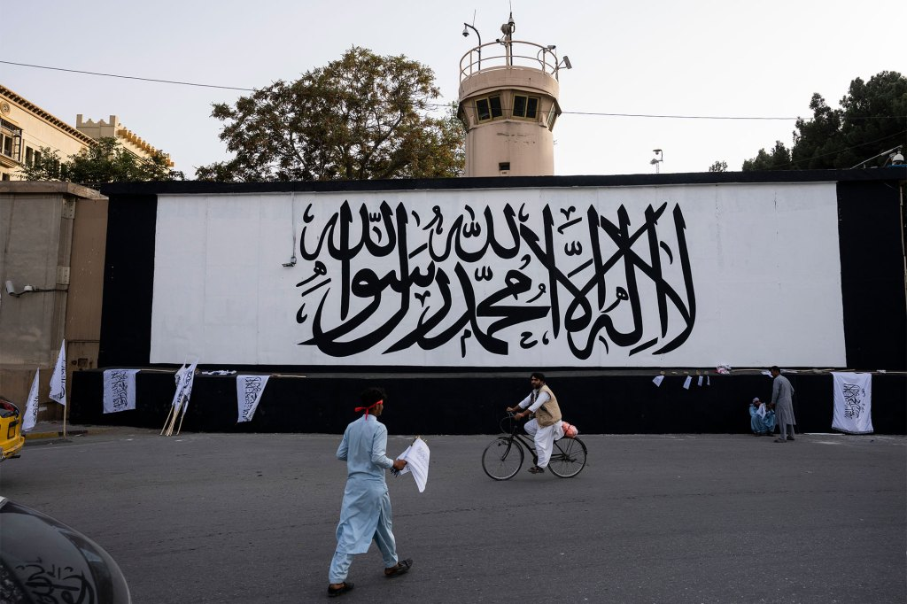 The Taliban flag is painted on a wall outside the American embassy compound in Kabul, Afghanistan.
