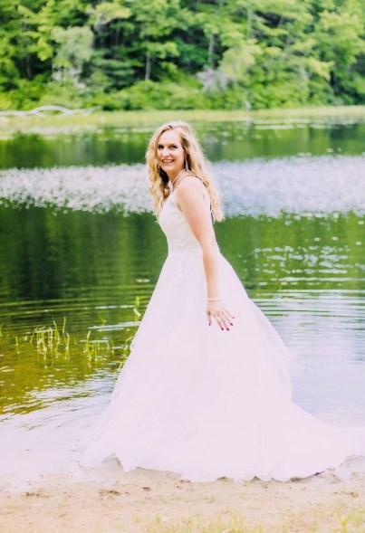 Chrissy Blake gives her wedding dress a soak in a lake.