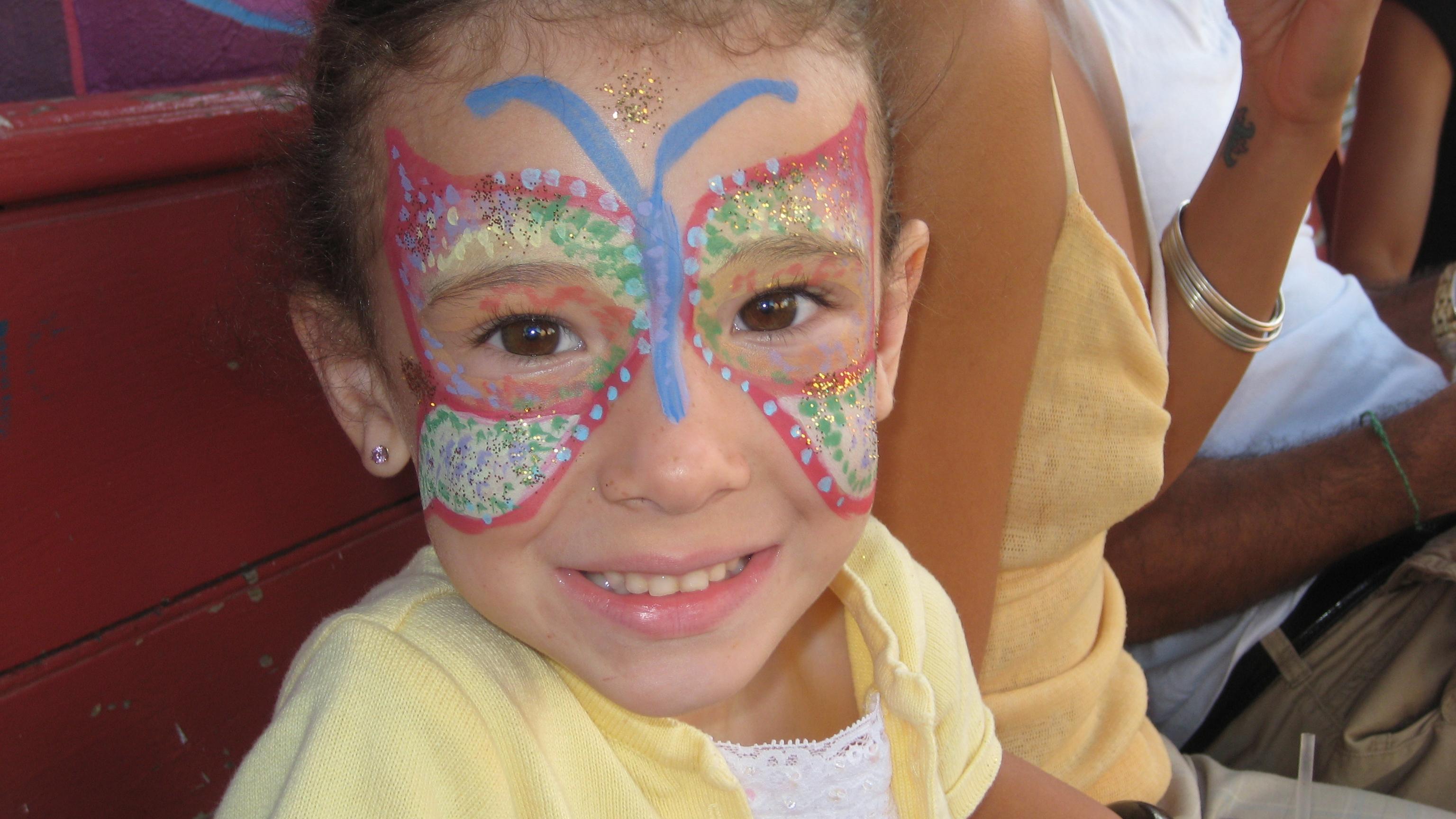 Butterfly facepaint on girl