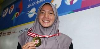Perenang Jawa Timur berusia 18 tahun Adinda Larasati Dewi, menajamkan rekornas di nomor 800 meter gaya bebas putri dan menjadi rekornya yang kedua dalam FAI 2018. (istimewa)
