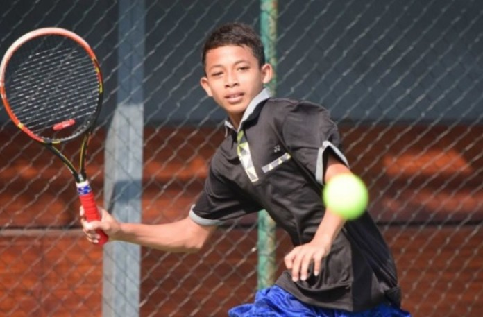 Faried Widya asal DKI Jakarta mulai menemui lawan-lawan sengit di ronde delapan besar tunggal putra KU-14, Kejurnas Tenis Yunior Detec Open 2018. (net)