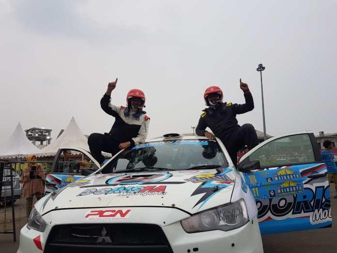 Rifat Sungkar bersama navigatornya M. Redwan dinobatkan sebagai juara nasional Kejurnas Sprint Rally 2019 .