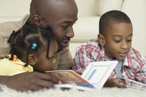 Man reading to children