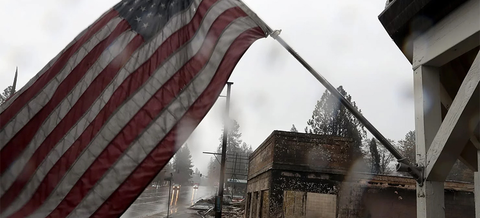 flag flying over CA town affected by wildfires