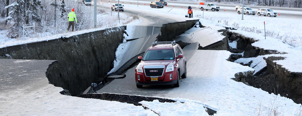 A vehicle lies stranded on a collapsed roadway near the airport after an earthquake in Anchorage, Alaska, U.S. November 30, 2018