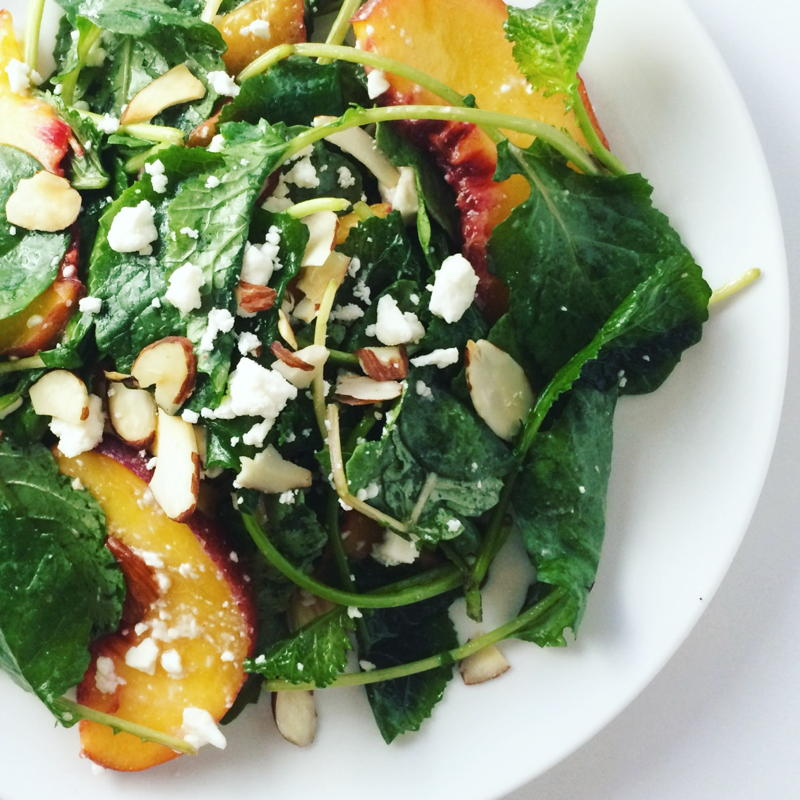 baby kale salad with peaches, feta cheese and toasted almonds   www.nyssaskitchen.com