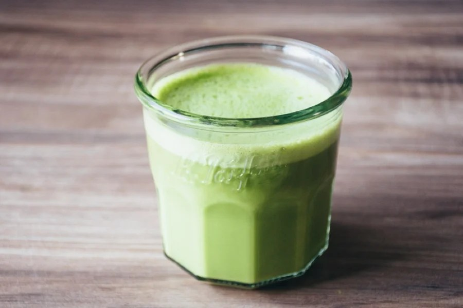 bulletproof matcha latte - a healthy, nutrient dense, energy boosting and delicious hot beverage made with matcha green tea powder, coconut oil, grass fed butter, vanilla extract and lightly sweetened with honey. recipes makes 2 servings. | www.nyssaskitchen.com
