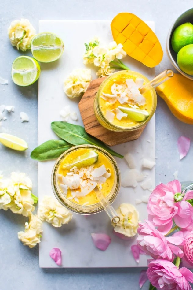 This mango coconut smoothie with turmeric and lime is not too sweet, but slightly floral and aromatic from the perfectly ripe mango, a bright clean layer of flavor from all that fresh lime juice that wakes up your taste buds, a little tropical creamy thing happening thanks to the coconut milk, and some anti-inflammatory love for your bod from the bold and vibrant turmeric.