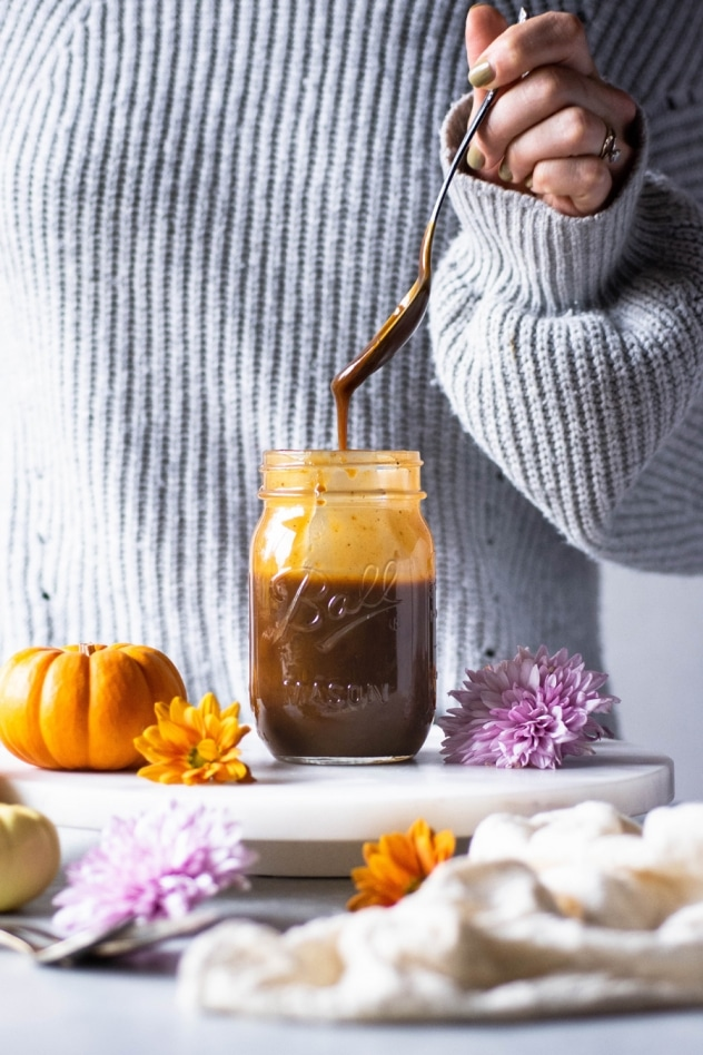 This paleo salted pumpkin caramel sauce is made with a few clean and simple ingredients like coconut milk, coconut sugar, real pumpkin, pumpkin spice, sea salt and vanilla extract. Easy to make and a healthy seasonal treat that you are going to LOVE dipping your spoon into!
