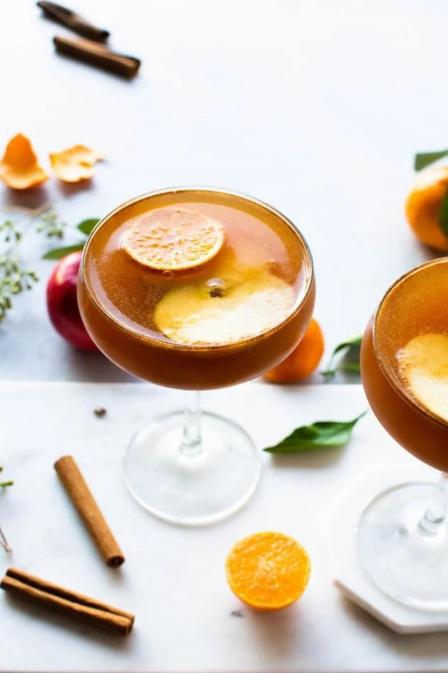 This spiced apple and tangerine spritz is the perfect fancy make-at-home drink for fall! Made with spiced rum (or vodka!), fresh apple cider, bright tangerine juice, and finished with sparkling hard apple cider for a festive and delicious beverage worthy of a toast!