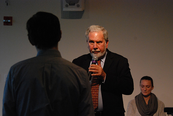 NYU President John Sexton addresses a student at the town hall on Oct. 1.