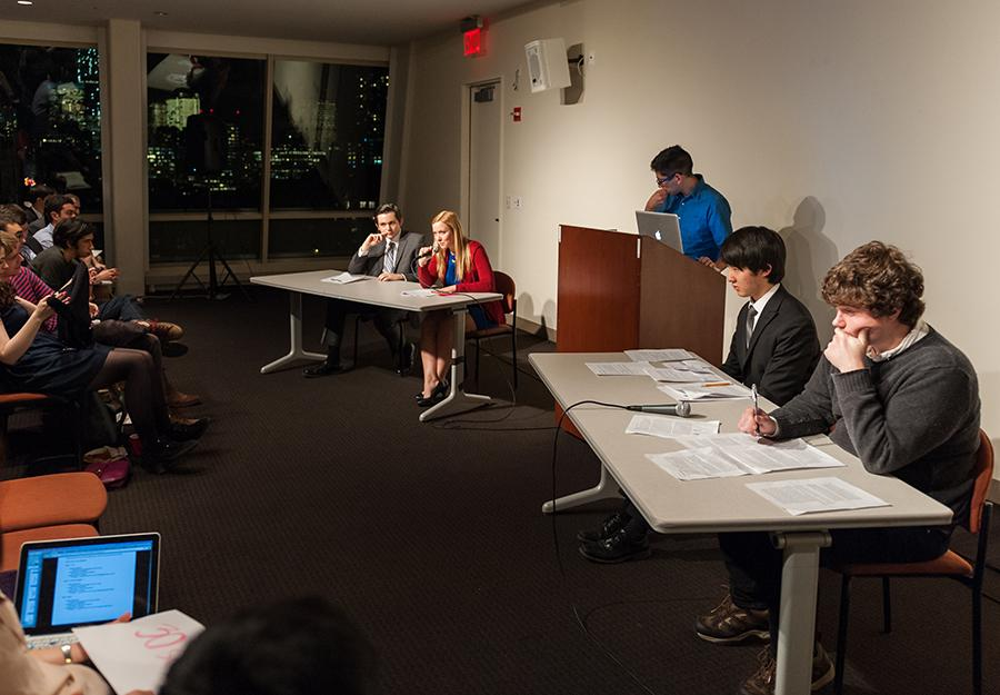 Megan Powers, Vice President of the NYU College Republicans, second from left, rebuts the stance taken on ISIL by her Democratic counterpart.