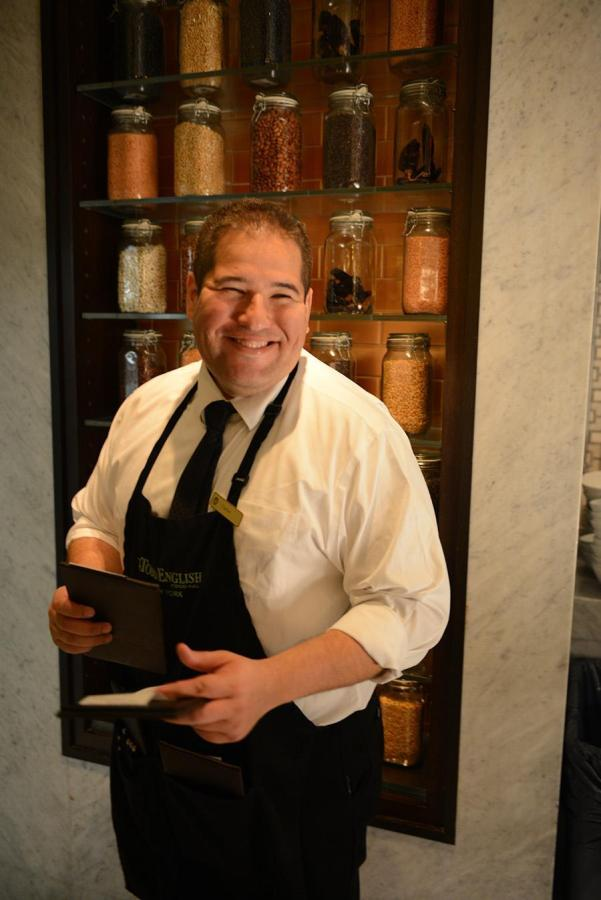 Carlos Sinde has worked as a waiter at The Plaza Hotel for four years.