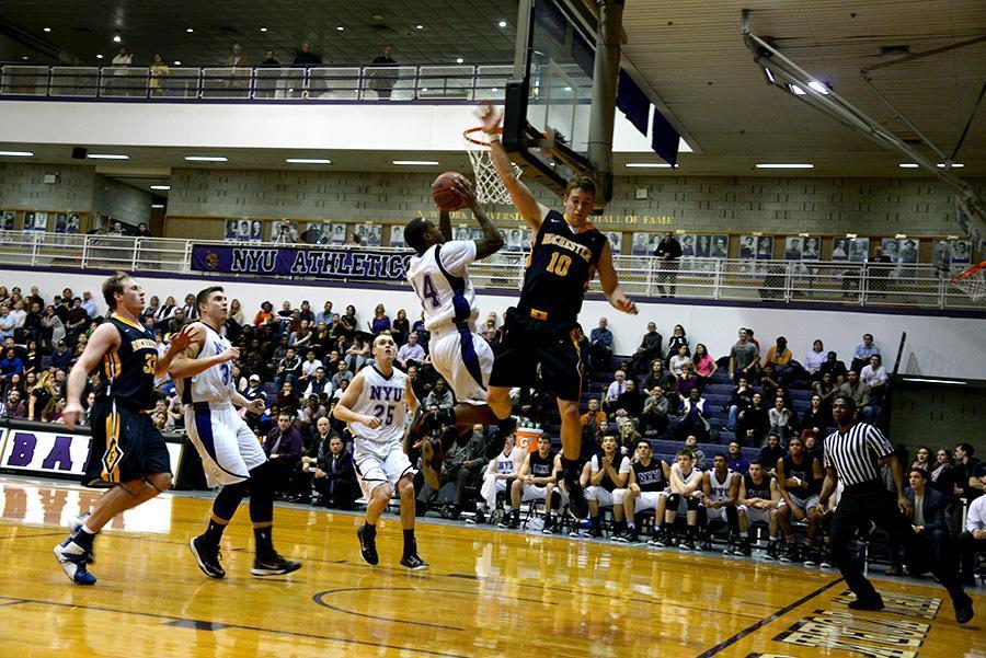 Junior Hakeem Harris scores against University of Rochester.