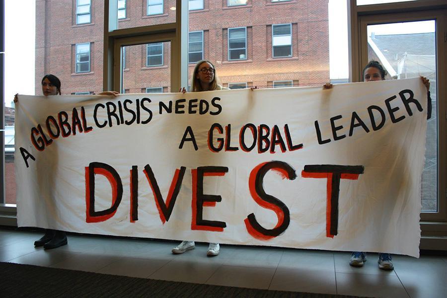Members of NYU Divest demonstrate during the University Senate meeting last Thursday.