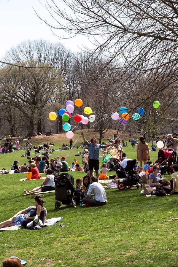 People relax in Prospect Park on a beautiful April day.