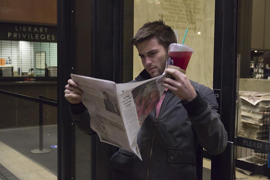WSN reader Austin O'Neill enjoying his new favorite paper.