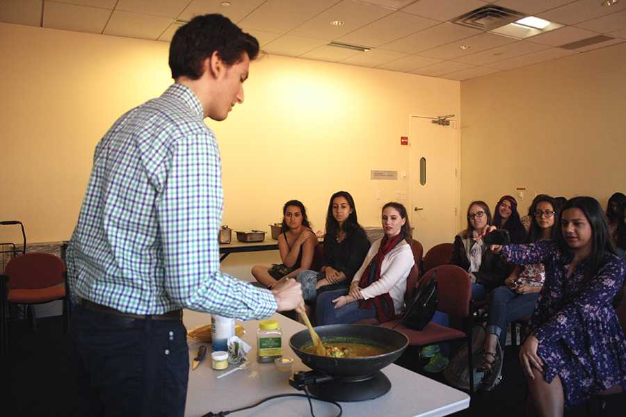 Krishna Bhakti president Jonathan Rosenthal does a cooking demonstration at a club meeting in the Kimmel Center on Monday, Sep. 14, 2015.
