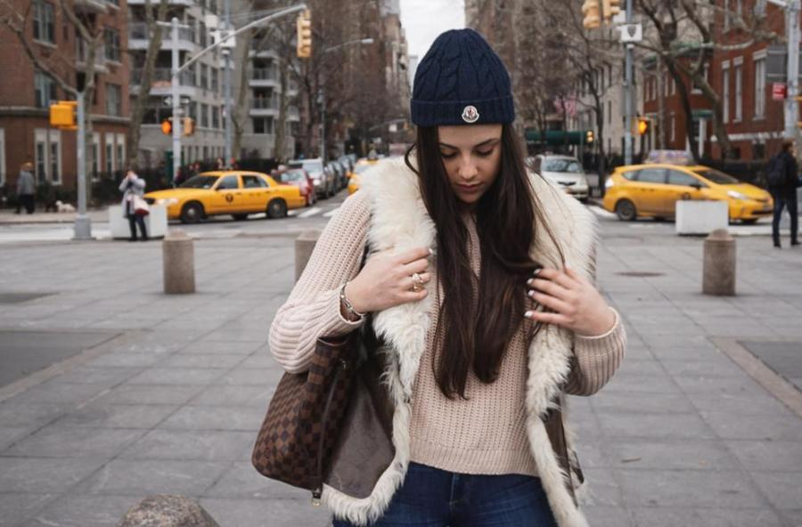 Sophomore Karolina Katsnelson poses in a chic fur vest and a light pink sweater.