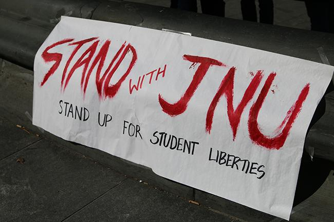 Students from NYU and Cooper Union gathered at Washington Square Park to stand in solidarity with JNU.