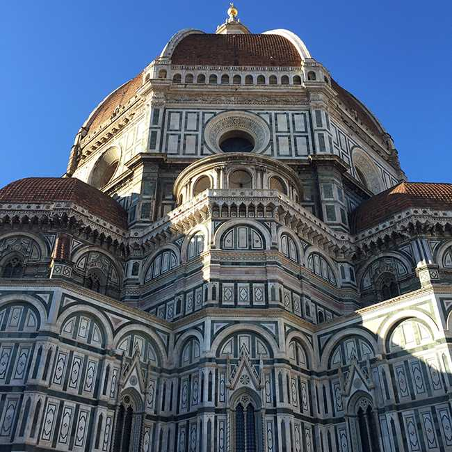 A view of the Duomo in Florence on a clear day.